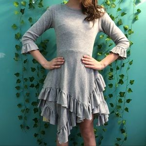 grey dress with ruffles at sleeves and bottom